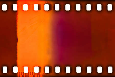 strips: 35mm color film strip sample with light leak Stock Photo