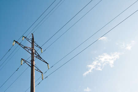 high voltage power supply line on a blue sky background photo