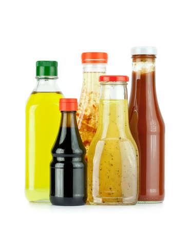 Glass bottles of sauces, oil and ketchup photo