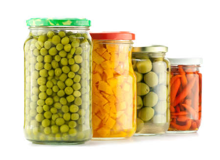 canned: Composition of preserved peas, pumpkin, olives and pepper Stock Photo