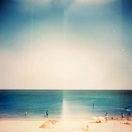 Retro medium format photo. Sunny day on the beach. Grain, blur added as vintage effect. photo