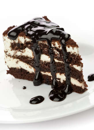 layer cake: Piece of cake with black chocolate syrup Stock Photo