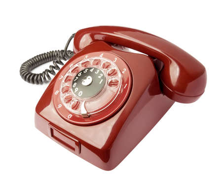 rotary dial telephone: Red old phone isolated on white background Stock Photo
