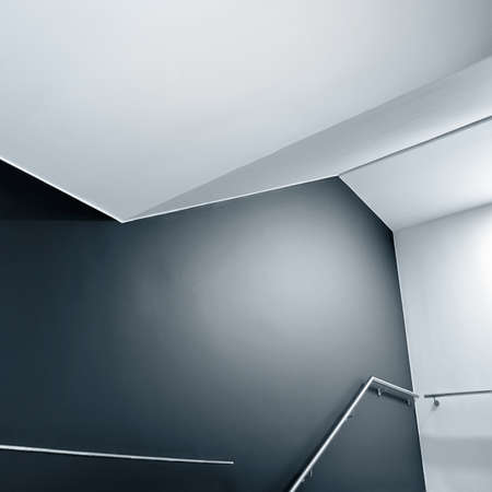 handhold: Abstract composition of empty modern building stairway.  Stock Photo