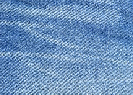 Worn blue denim jeans texture, background photo