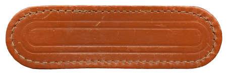 Blank worn leather label isolated on white background photo