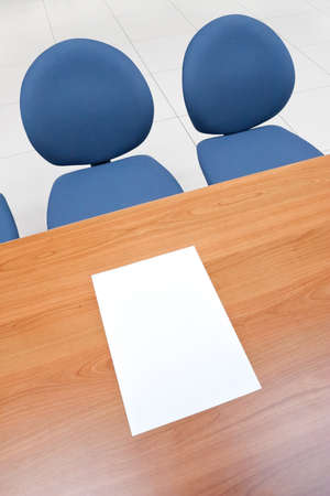 Office table with blank paper sheet on it and chairs. Stock Photo - 9230026