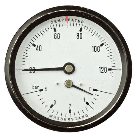 Old circular industrial temperature and pressure meter, thermometer. photo