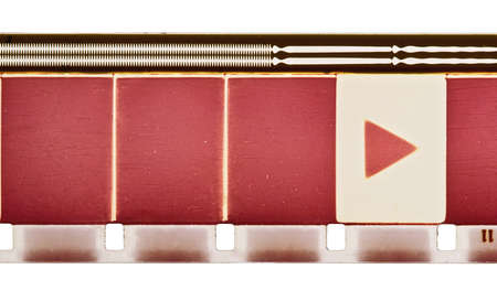 soundtrack: 16mm motion film strip sample with frames, soundtrack and play symbol. Isolated on white background. Stock Photo