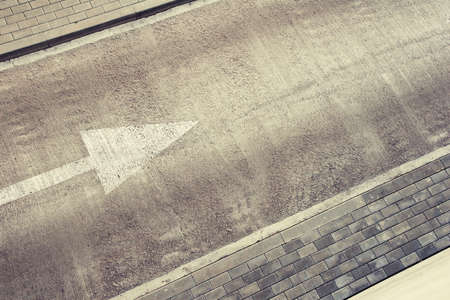 Empty road area with direction arrow and pavement. Can be used as background for text. Stock Photo - 9261179