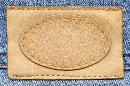 Blank leather jeans label sewed on a blue jeans. Can be used as background for your text. Stock Photo - 9357367