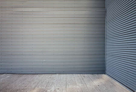 Tin wall background with concrete floor.