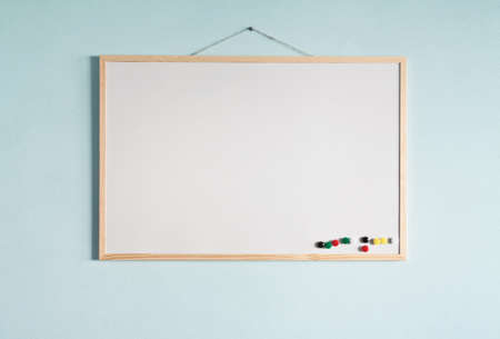 pin board: Message board hanging on a blue wall. Stock Photo