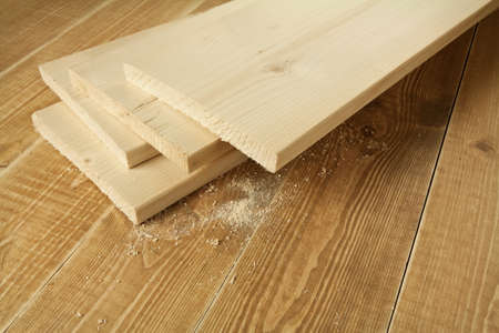 carpenter items: Wood planks on wooden table