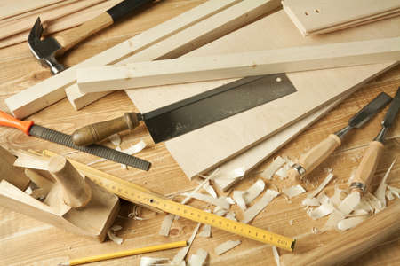 shavings: Wooden workshop table with tools. Stock Photo