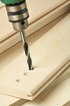 Drilling hole in a wooden plank. Stock Photo - 9568958