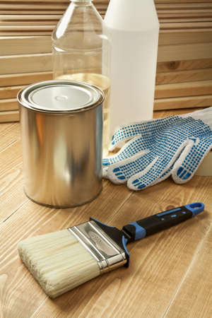 carpenter items: Painting tools on wooden floor. Stock Photo