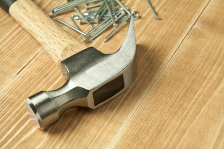 Wooden planks, hammer and nails. photo