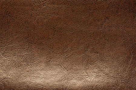 corrugation: Brown leather background closeup