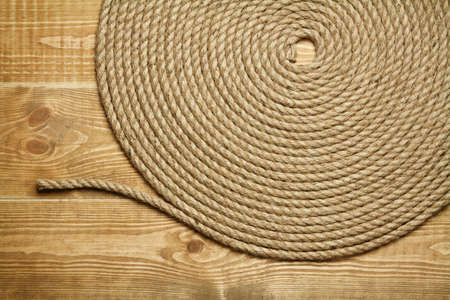Roll of rough rope on wooden background Stock Photo - 9615199