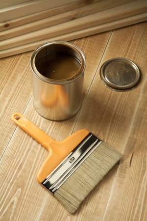 Painting tools on wooden floor. photo