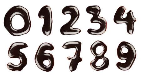 jarabe: N�meros escritos con sirope de chocolate, aislado