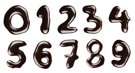 collage alphabet: Numbers written with chocolate syrup, isolated Stock Photo