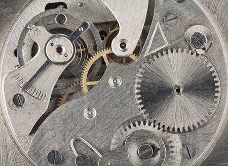 Old clock mechanic inside, clockwork close up. photo