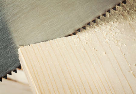 Wood workshop. Hand saw cutting plank. Stock Photo - 10205072