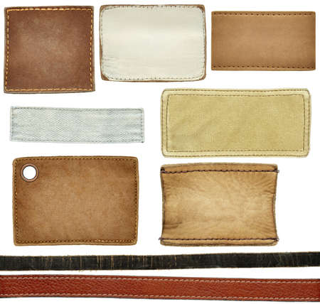leather background: Blank leather, textile jeans labels, straps isolated on white background Stock Photo