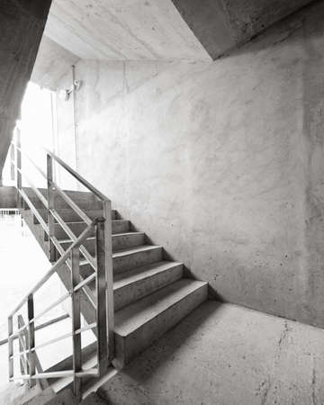 parapet wall: Empty concrete building stairway composition.