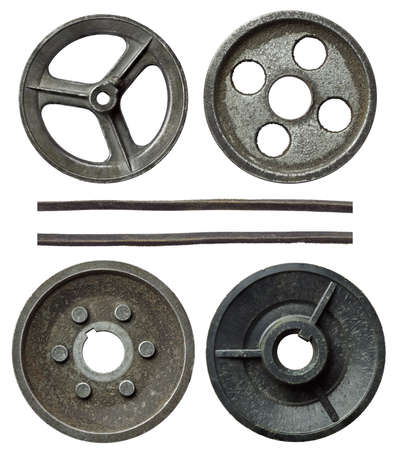 pulleys: Old metal pulleys with belt.