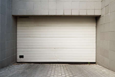 housing lot: Close white garage door Stock Photo