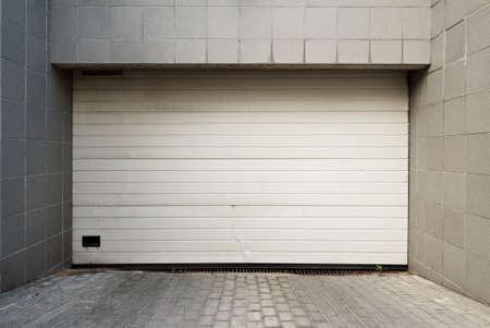 garage: Close white garage door Stock Photo