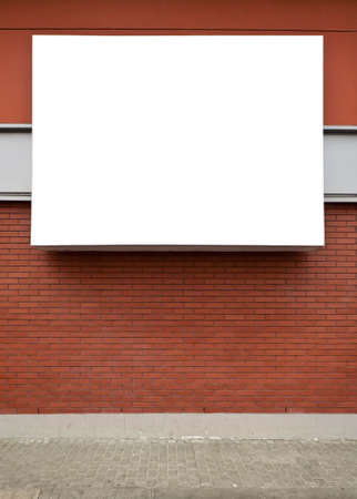 Blank advertising billboard on brick wall. photo