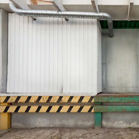 Empty warehouse wall, can be used as industrial background photo