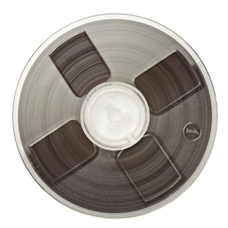 Vintage magnetic audio reel, isolated. photo