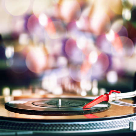 entertainment: Vinyl record spinning on DJ player Stock Photo
