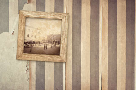 Aged room wall with hanging old picture. Image designed. photo