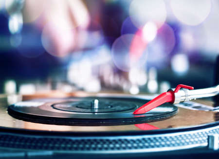 turntables: Vinyl record spinning on DJ player Stock Photo