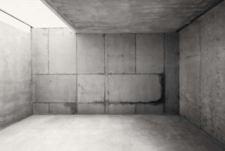 jail: Empty warehouse room with concrete walls and floor.