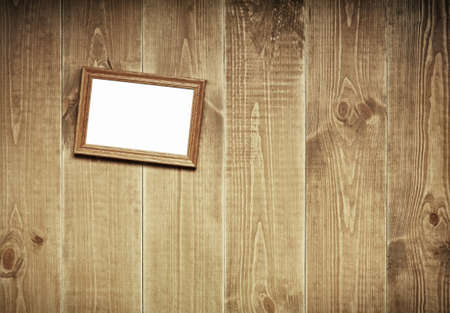 Aged wooden wall with hanging picture. photo