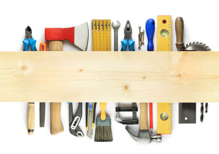 Carpentry background. Tools underneath the wood plank. photo