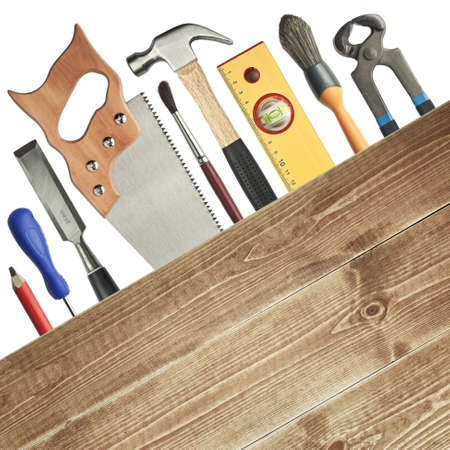 Carpentry background. Tools underneath the wood plank. Stock Photo - 10993324