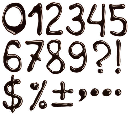 Numbers and symbols written with chocolate syrup. photo