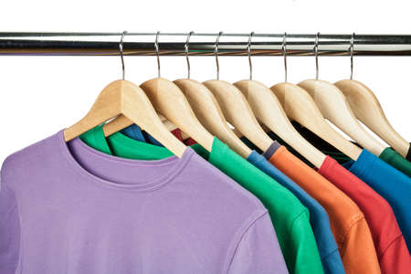 clothes hangers: Colorful t-shirts on the hanger  Stock Photo