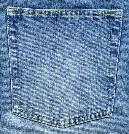 Worn blue denim jeans pocket