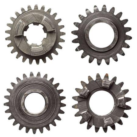 tuercas y tornillos: Engranajes de la máquina, ruedas dentadas de metal. Aislado en blanco. Foto de archivo