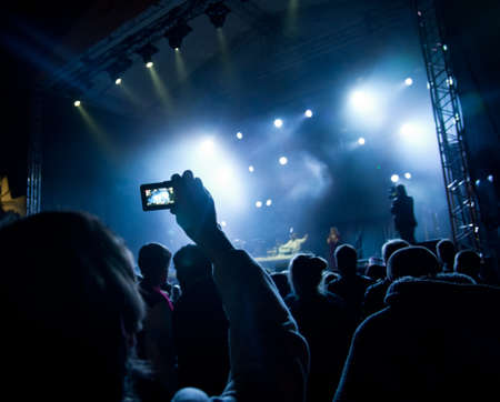 illumination: people watching open air concert Stock Photo