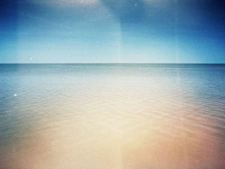 lake beach: Designed retro photo. Sunny day on the beach. Grain, dust, colors added as vintage effect. Stock Photo